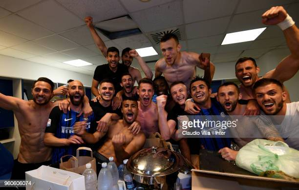 Players of FC Internazionale and team celebrate the victory and the qualification for the Champions League in the dressing room during the Serie A...