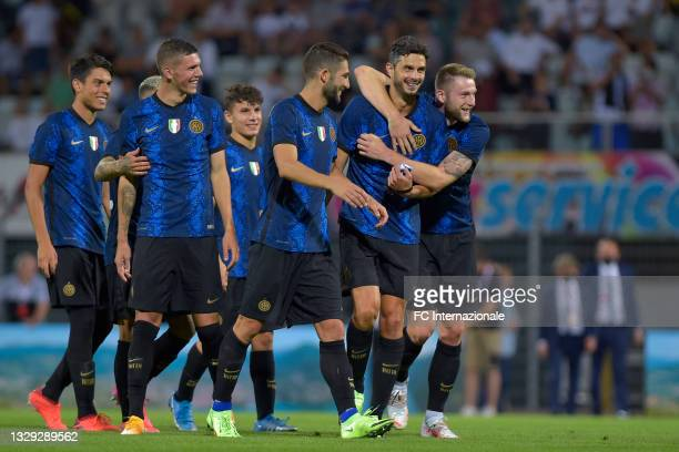 Players of FC Internazionale celebrate after the friendly match pre-season between FC Lugano and FC Internazionale on July 17, 2021 in Lugano,...
