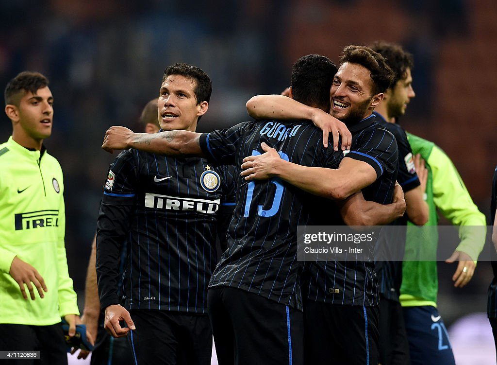 Players of FC Internazionale celebrate at the end of the Serie A match between FC Internazionale Milano and AS Roma at Stadio Giuseppe Meazza on April 25, 2015 in Milan, Italy.