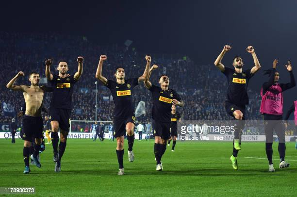 Players of FC Internazionale celebrate at the end of the Serie A match between Brescia Calcio and FC Internazionale at Stadio Mario Rigamonti on...