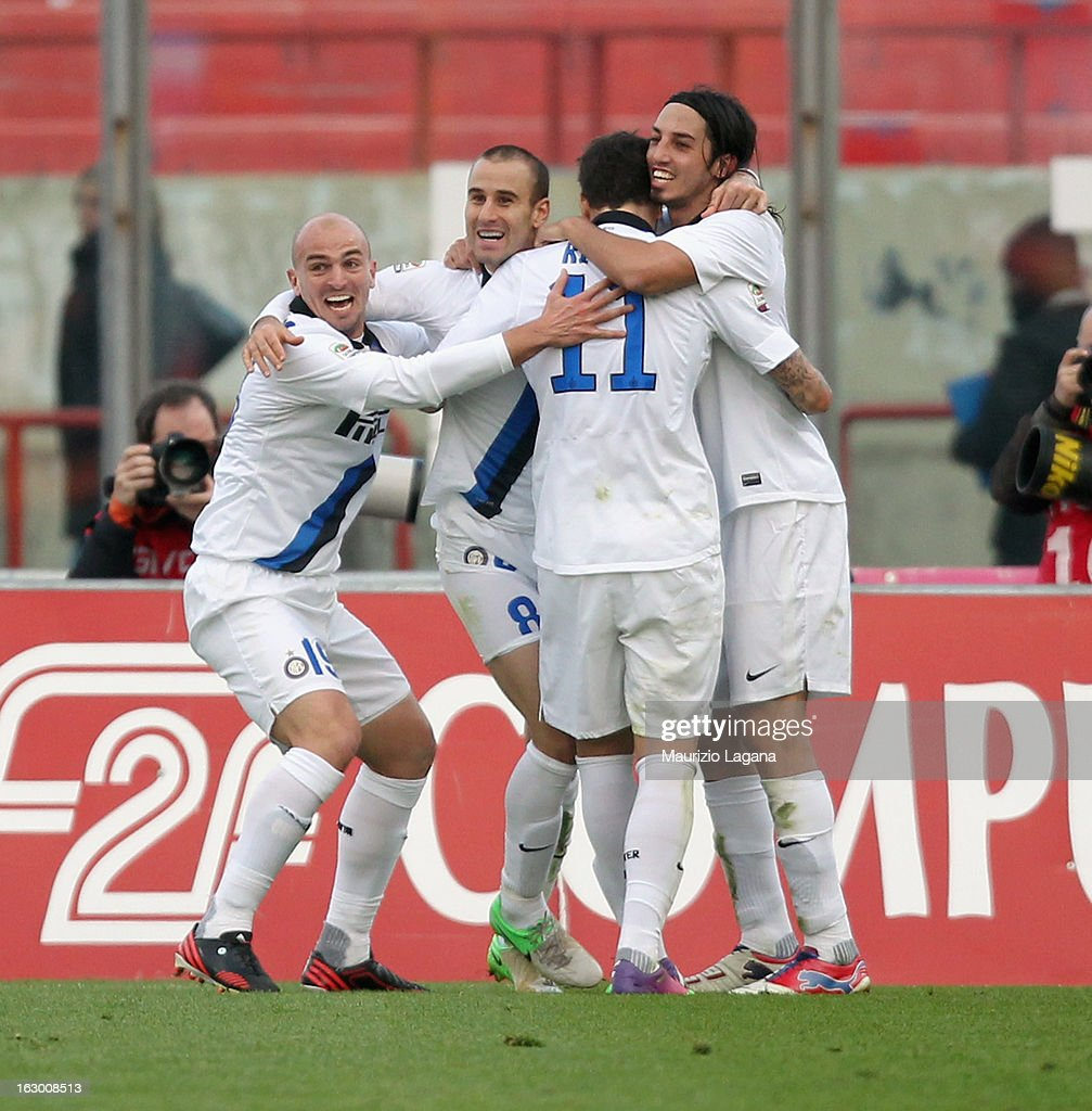 Players of FC Internazionale celebrate the victory goal during the Serie A match between Calcio Catania and FC Internazionale Milano at Stadio Angelo Massimino on March 3, 2013 in Catania, Italy.
