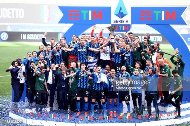 Players of Fc Internazionale celebrate their league championship victory during the awards ceremony after the Serie A match between Fc Internazionale...