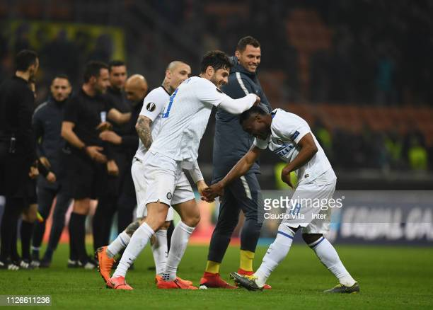 Players of FC Internazionale celebrates a victory at the end of the UEFA Europa League Round of 32 Second Leg match between FC Internazionale and SK...