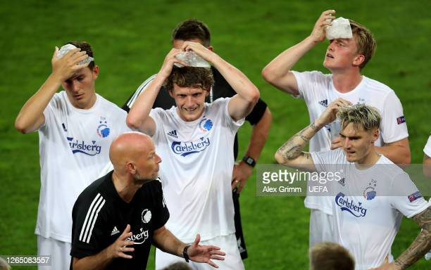 Players of FC Kobenhavn react at the end of the match as the game goes to extra time during the UEFA Europa League Quarter Final between Manchester...