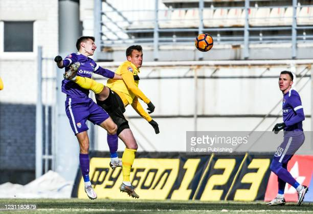 Players of FC Mariupol and FC Oleksandriia are seen in action during the Ukrainian Premier League Matchday 14 game at the Slavutych Arena,...