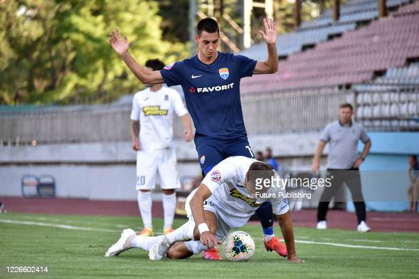 Players of FC Mariupol and FC Olimpik Donetsk are seen in action during the Ukrainian Premier League Matchday 30 game in Mariupol, Donetsk Region,...