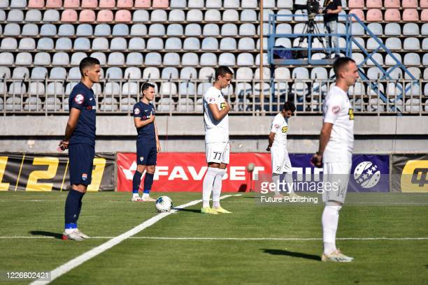 Players of FC Mariupol and FC Olimpik Donetsk are seen on the pitch during the Ukrainian Premier League Matchday 30 game in Mariupol, Donetsk Region,...