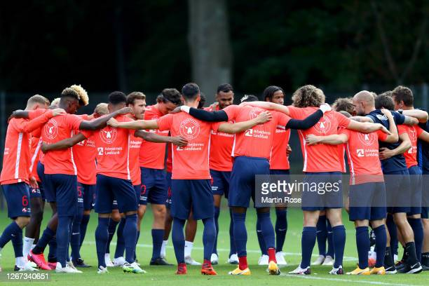 Players of FC Midtjylland are seen in the huddle prior to the preseason friendly match between Hamburger SV and FC Midtjylland at Volksparkstadion on...