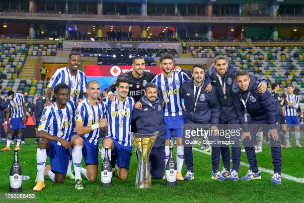 Players of FC Porto pose with Candido de Oliveira trophy following his sides victory during the Portuguese Super Cup match between FC Porto and SL...
