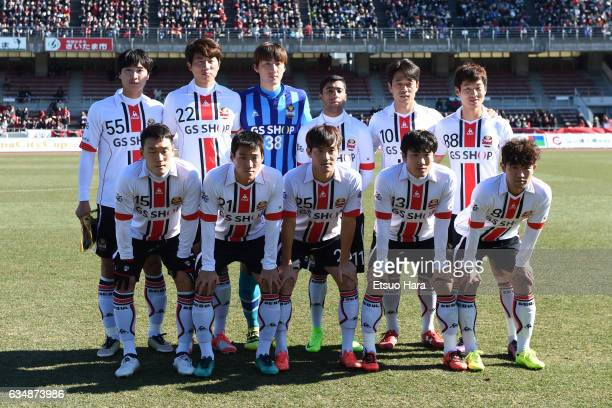 Players of FC Seoul line up for team photos prior to the preseason friendly between Urawa Red Diamonds and FC Seoul at Urawa Komaba Stadium on...
