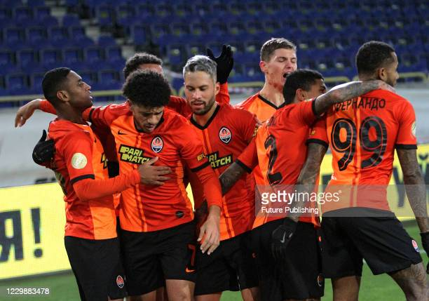 Players of FC Shakhtar Donetsk celebrate upon midfielder Tete's scoring in the 88th minute during the Ukrainian Premier League Matchday 11 game...