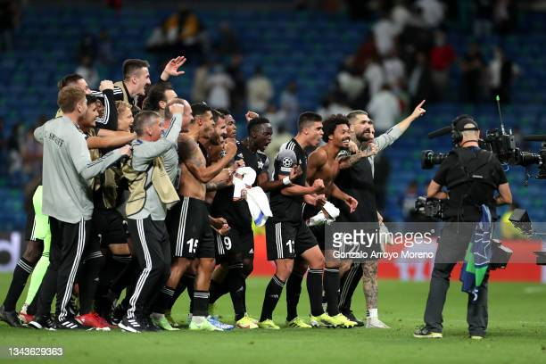 Players of FC Sheriff celebrate after victory in the UEFA Champions League group D match between Real Madrid and FC Sheriff at Estadio Santiago...