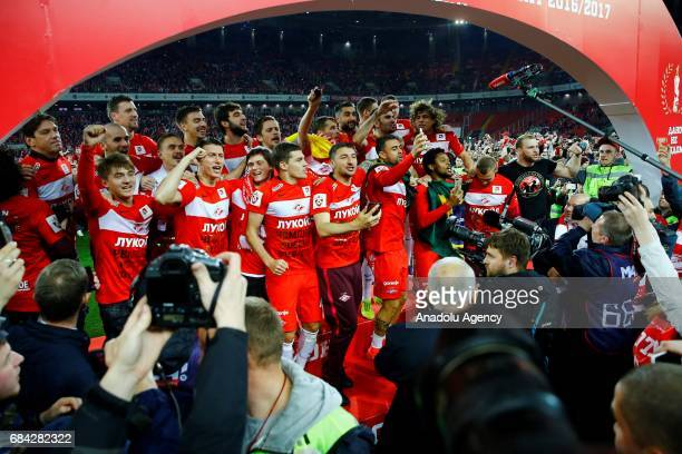 Players of FC Spartak Moscow celebrate with trophy along with their team's fans after winning the Russian Premier League championship following the...