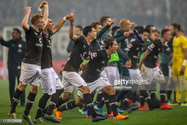 Players of FC St. Pauli celebrate after winning the Second Bundesliga match between FC St. Pauli and Hamburger SV at Millerntor Stadium on September...