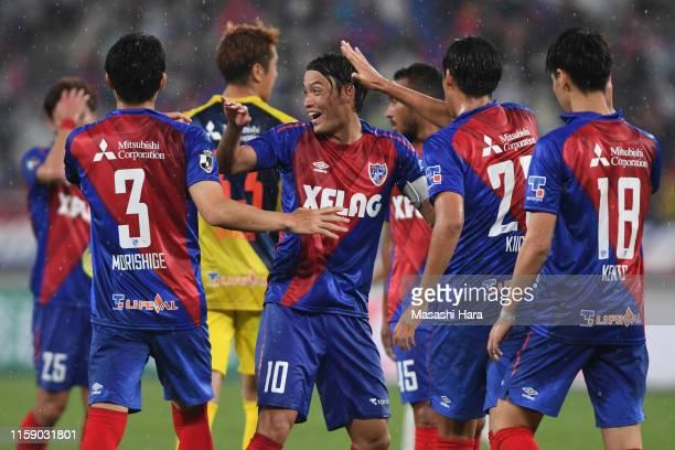 Players of FC Tokyo celebrate the win during the J.League J1 match between FC Tokyo and Yokohama F.Marinos at Ajinomoto Stadium on June 29, 2019 in...
