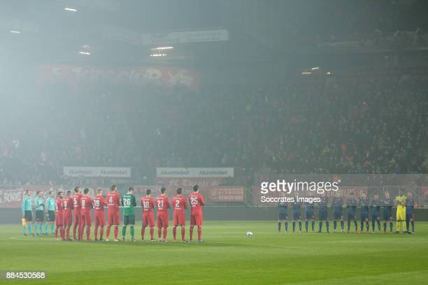 Players of FC Twente and Ajax pay tribute with a one minute applause to Dick Wessels during the Dutch Eredivisie match between Fc Twente v Ajax at...