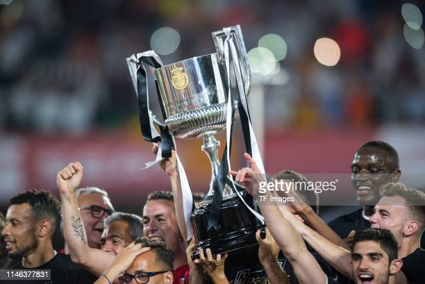 Players of FC Valencia celebrate with the trophy after the Spanish Copa del Rey match between Barcelona and Valencia at Estadio Benito Villamarin on...