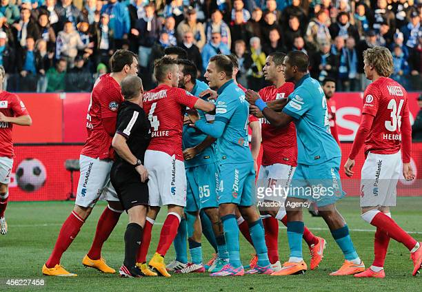 Players of FC Zenit Saint Petersburg and FC Spartak Moscow react to each other during the Russian Premier League football match between FC Zenit...