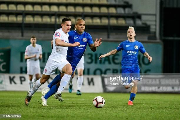 ZAPORIZHZHIA UKRAINE Players of FC Zorya Luhansk and PFC Lviv are seen in action during the Ukrainian Premier League Matchday 21 game in Zaporizhzhia...