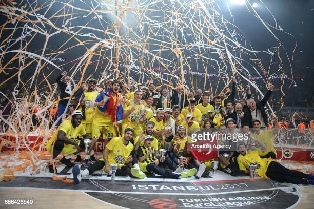 Players of Fenerbahce celebrate their victory in Turkish Airlines Euroleague Final Four championship after the final match between Fenerbahce and...