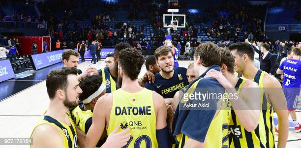 Players of Fenerbahce Dogus Istanbul celebrate victory during the 2017/2018 Turkish Airlines EuroLeague Regular Season Round 19 game between Anadolu...