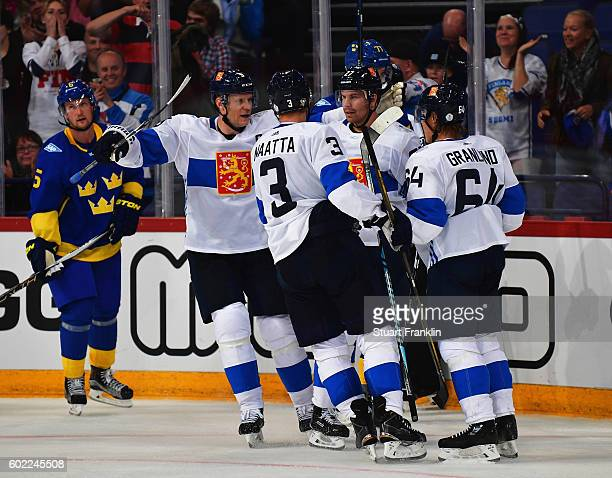Players of Finland celebrate the second goal during the World Cup of Hockey game between Finland and Sweden at the Hartwell Areena on September 8...