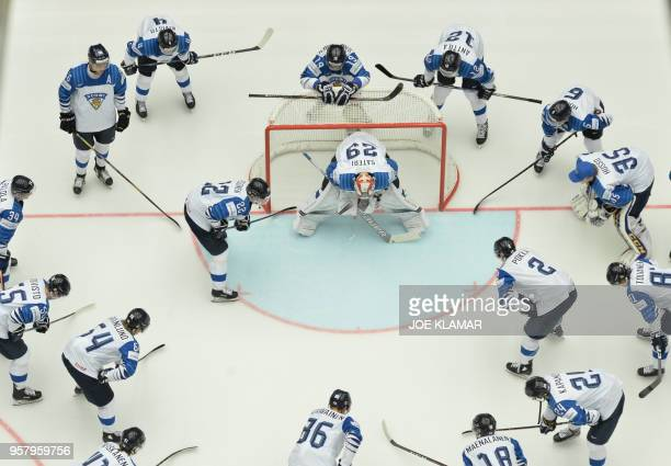 Players of Finland take a moment around Finland's goalkeeper Harri Sateri during the group B match Canada vs Finland of the 2018 IIHF Ice Hockey...