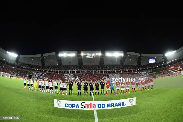 Players of Flamengo and America RN pose for photo before a match between Flamengo and America RN as part of Copa do Brasil 2014 at Arena das Dunas on...