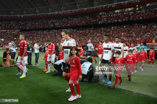 Players of Flamengo and Internacional enter to the field before a match between Internacional and Flamengo as part of Copa CONMEBOL Libertadores 2019...