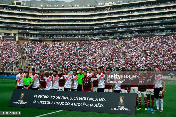 Players of Flamengo and River Plate pose prior to the final match of Copa CONMEBOL Libertadores 2019 between Flamengo and River Plate at Estadio...