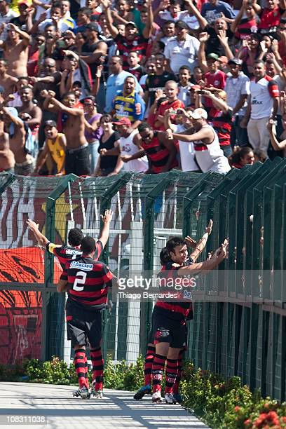Players of Flamengo celebrate a goal scored by Frauches during the match against Bahia as part of Sao Paulo Juniors Cup 2011 at Pacaembu stadium on...