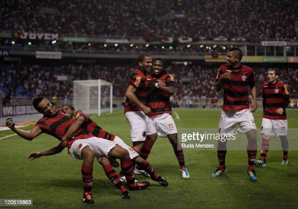 Players of Flamengo celebrate a scored goal againist Coritiba during a match as part of Serie A 2011 at Engenhao stadium on August 06, 2011 in Rio de...