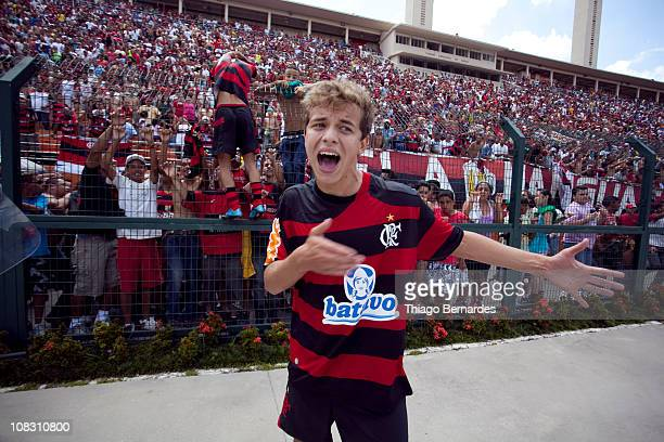 Players of Flamengo celebrate with supporters after the soccer against Bahia as part of the Sao Paulo Juniors Cup 2011 at Pacaembu Stadium on January...