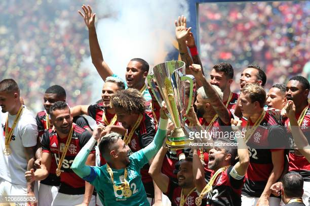 Players of Flamengo celebrate with the champions trophy of the Brazilian Supercopa after their victory by 3-0 against Athletico PR at Mane Garrincha...