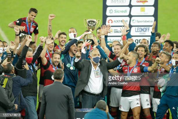 Players of Flamengo lift the trophy after after winning a second leg match against Fluminense as part of the Campeonato Carioca Final at Maracana...