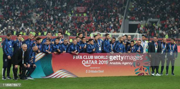 Players of Flamengo pose for a photo during the cup ceremony at the end of the FIFA Club World Cup Qatar 2019 Final match between Liverpool FC and CR...