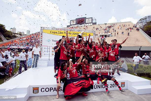 Players of Flamengo raise the trophy after the soccer match against Bahia as part of the Sao Paulo Juniors Cup 2011 at Pacaembu Stadium on January 25...