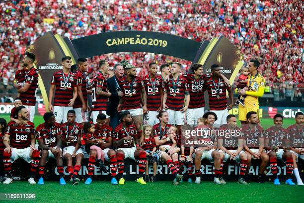 Players of Flamengo sit in the podium after receiving their medals after during the final match of Copa CONMEBOL Libertadores 2019 between Flamengo...