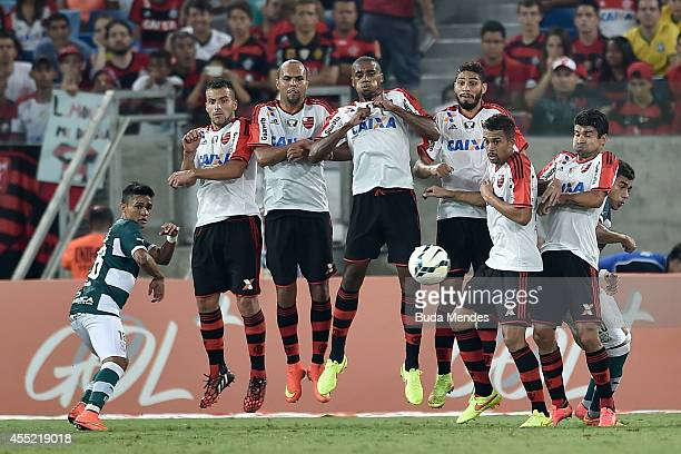 Players of Flamengo struggles for the ball during a match between Goias and Flamengo as part of Brasileirao Series A 2014 at Arena Pantanal on...