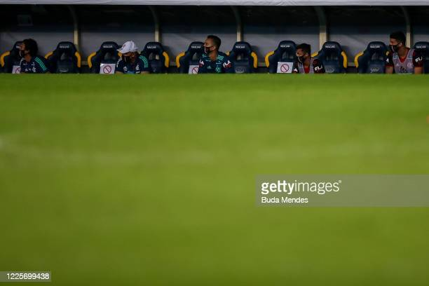 Players of Flamengo wearing face masks watch by the sidelines during the match between Flamengo and Fluminense as part of the Taca Rio the Second Leg...