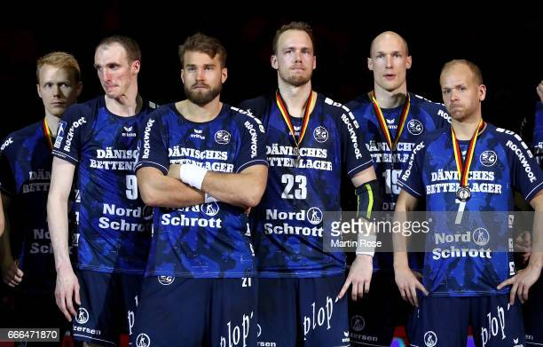 Players of Flensburg look dejected after losing the Rewe Final Four final match between SG FlensburgHandewitt and Thw Kiel at Barclaycard Arena on...