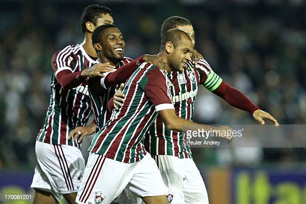 Players of Fluminense celebrate a scored goal during the match between Fluminense and Coritiba for the Brazilian Serie A 2013 on June 06, 2013 in...