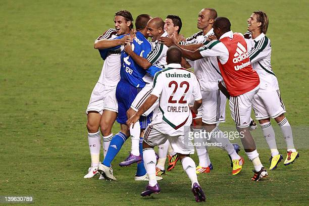 Players of Fluminense celebrate a victory againist Botafogo during the semifinal match as part of Rio State Championship 2012 at Engenhao Stadium on...