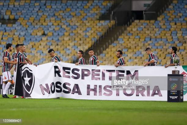 Players of Fluminense hold a flag that reads Respect Our History prior to the match between Flamengo and Fluminense as part of the Taca Rio the...