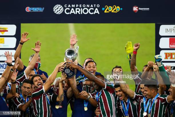 Players of Fluminense lift the trophy after defeating Flamengo as part of the Taca Rio the Second Leg of the Carioca State Championship at Maracana...