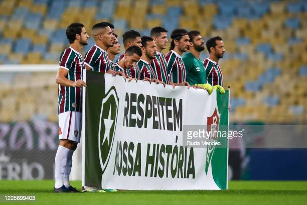 Players of Fluminense pose for a photo holding a flag that reads Respect Our History prior to the match between Flamengo and Fluminense as part of...