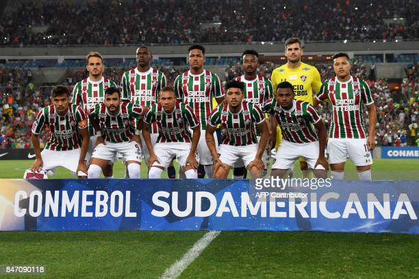 Players of Fluminense pose for a photo prior to the first leg match between Fluminense and Liga Deportiva Universitaria de Quito as part of round of...