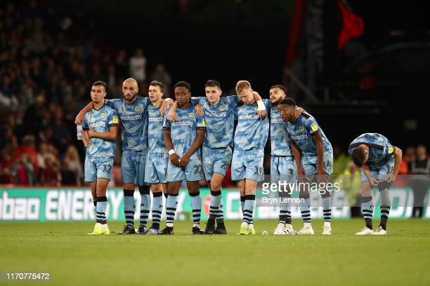 Players of Forest Green Rovers look dejected during the penalty shootout in the Carabao Cup Second Round match between AFC Bournemouth and Forest...