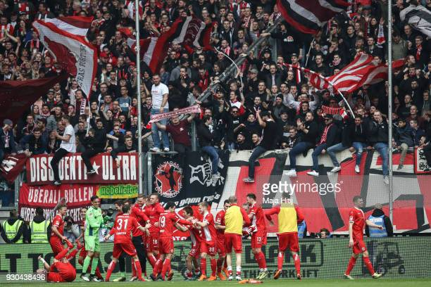 Players of Fortuna Duesseldorf celebrate with fans after the Second Bundesliga match between MSV Duisburg and Fortuna Duesseldorf at...