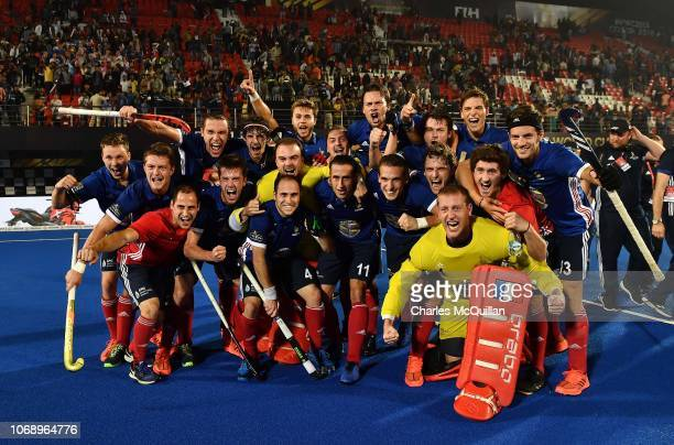 Players of France celebrate after the final whistle during the FIH Men's Hockey World Cup Pool A match between Argentina and France at Kalinga...